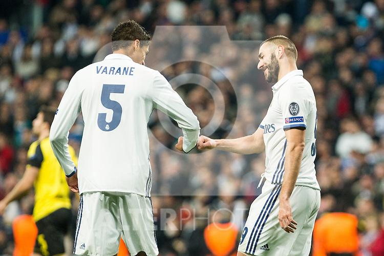 Real Madrid's Karim Benzema , Raphael Varane during Champions League match between Real Madrid and Borussia Dortmund  at Santiago Bernabeu Stadium in Madrid , Spain. December 07, 2016. (ALTERPHOTOS/Rodrigo Jimenez)