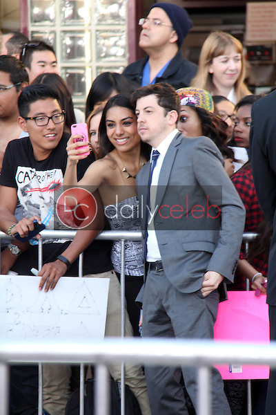 """Christopher Mintz-Plasse and fan<br /> at the """"Neighbors"""" World Premiere, Village Theater, Westwood, CA 04-28-14<br /> David Edwards/DailyCeleb.com 818-249-4998"""