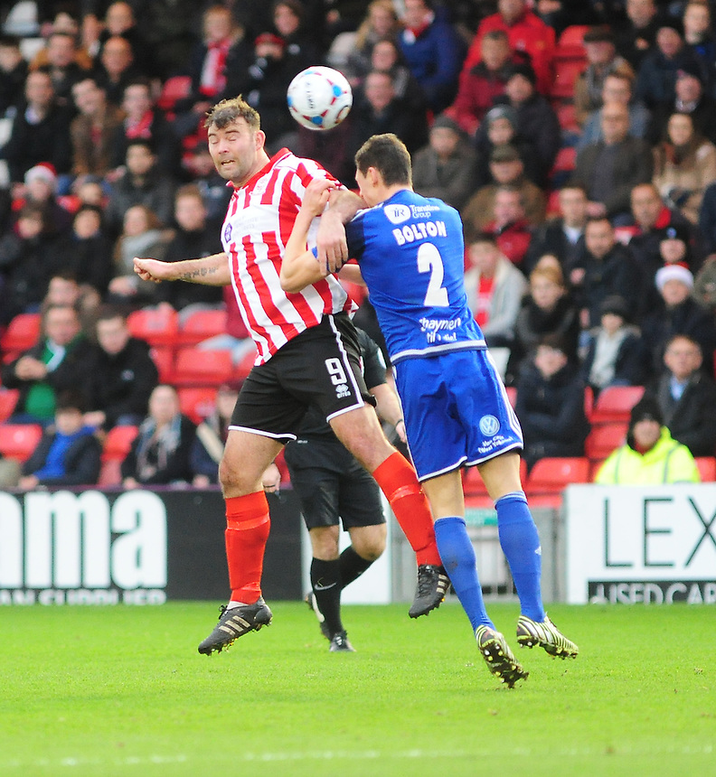 Lincoln City's Matt Rhead vies for possession with FC Halifax Town's James Bolton<br /> <br /> Photographer Andrew Vaughan/CameraSport<br /> <br /> Football - Vanarama National League - Lincoln City v FC Halifax Town - Saturday 26th December 2015 - Sincil Bank - Lincoln<br /> <br /> &copy; CameraSport - 43 Linden Ave. Countesthorpe. Leicester. England. LE8 5PG - Tel: +44 (0) 116 277 4147 - admin@camerasport.com - www.camerasport.com