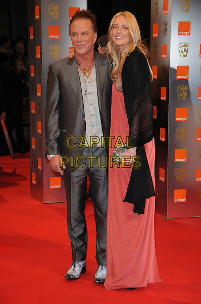 MICKEY ROURKE & ELENA KULETSKAYA.Arrivals at the Orange British Academy Film Awards 2010 at the Royal Opera House, Covent Garden, London, England, UK, .21st February 2010.BAFTA BAFTAs full length grey gray suit red burnt orange long maxi dress black jacket clutch bag sparkly shoes couple wrap shawl pashmina .CAP/CAS.©Bob Cass/Capital Pictures