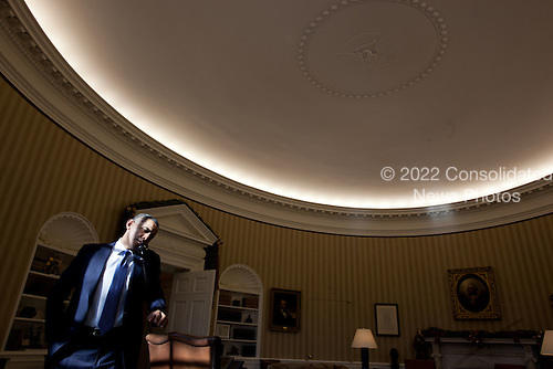 United States President Barack Obama talks on the phone in the Oval Office in the White House in Washington, D.C., December 19, 2011. .Mandatory Credit: Pete Souza - White House via CNP