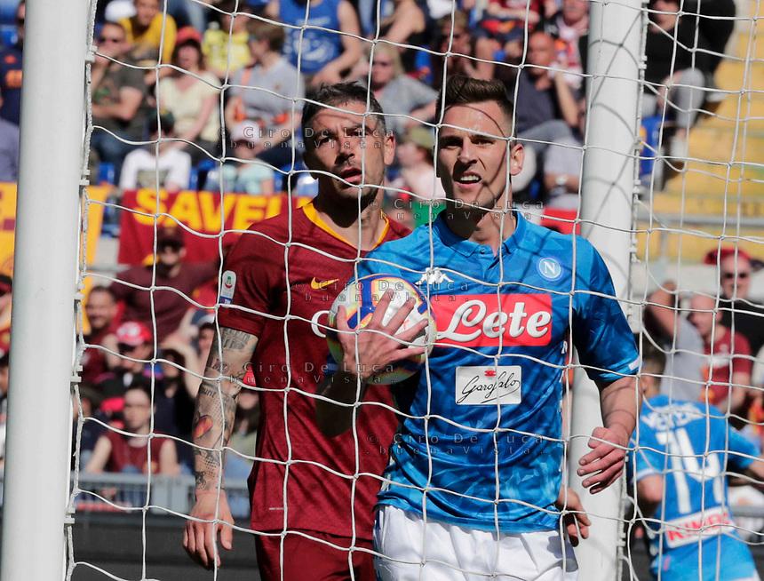 Arkadiusz Milik of Napoli   and Edin Dzeko of AS Roma  during the  italian serie a soccer match, AS Roma -  SSC Napoli       at  the Stadio Olimpico in Rome  Italy , March 31, 2019