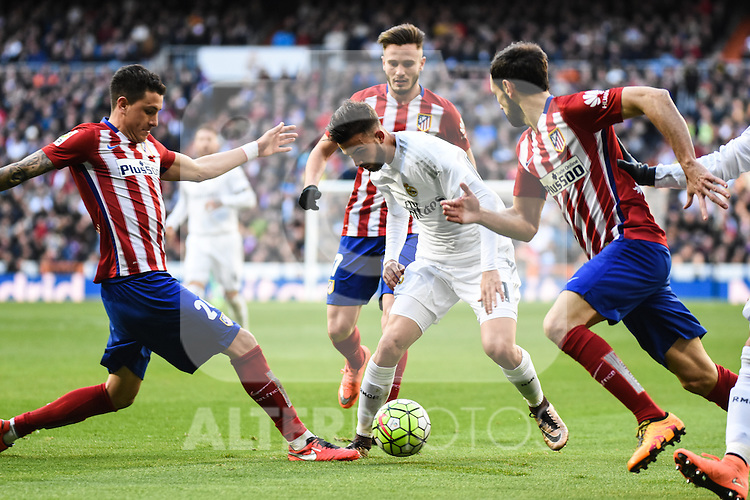 Real Madrid´s Mayoral and Atletico de Madrid´s Carrasco, Saul Niguez, Juanfran during 2015/16 La Liga match between Real Madrid and Atletico de Madrid at Santiago Bernabeu stadium in Madrid, Spain. February 27, 2016. (ALTERPHOTOS/Javier Comos)