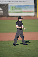 Umpire Patrick Faerber handles the calls on the bases during the game between the Ogden Raptors and the Missoula Osprey at Lindquist Field on July 12, 2018 in Ogden, Utah. Missoula defeated Ogden 11-4. (Stephen Smith/Four Seam Images)