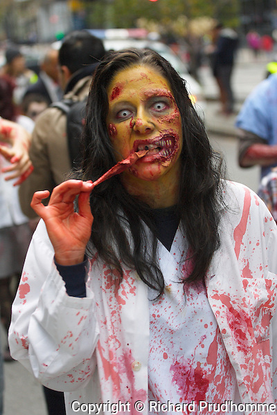 A female zombie eating a piece of flesh