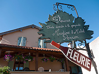 France, FRA, Département Rhone, Beaujolais, Fleurie, 2009Jul23: A winery advertises their Beaujolais wine from Fleurie with a sign at a facade.