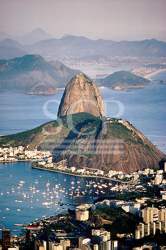 Rio de Janeiro, Brazil. The Sugar Loaf (Pao de Acucar) in Guanabara Bay with the Gloria yacht Marina.