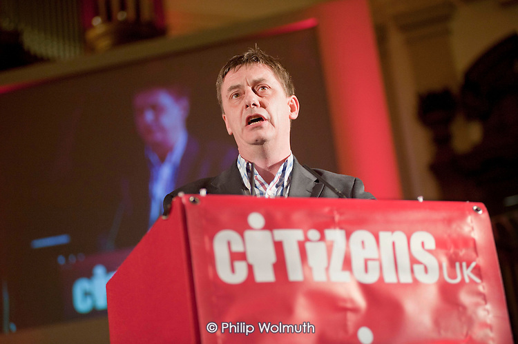 """Chris Baugh, Assistant General Secretary of the PCS trade union, addresses a """"Day for Civil Society"""" organized by Citizens UK / London Citizens to celebrate 10 years of the Living Wage Campaign, launch a National Living Wage Foundation and call for the living wage to be adopted nationally.  Central Hall, Westminster."""