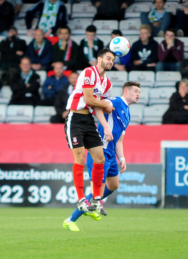 Lincoln City's Sam Habergham vies for possession with North Ferriby United's Conner Robinson<br /> <br /> Photographer Andrew Vaughan/CameraSport<br /> <br /> Football - Vanarama National League - Lincoln City v North Ferriby United - Tuesday 9th August 2016 - Sincil Bank - Lincoln<br /> <br /> &copy; CameraSport - 43 Linden Ave. Countesthorpe. Leicester. England. LE8 5PG - Tel: +44 (0) 116 277 4147 - admin@camerasport.com - www.camerasport.com