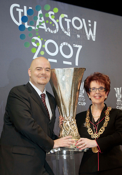 Gianni Infantino Uefa representative hands the Cup to Glasgow's Lord Provost Liz Cameron  during the UEFA Cup Final hand over to the City of Glasgow after Quarterfinal Draw at Glasgow's Fruit Market..Maurice McDonald Universal News/Photo.  16/3/2007