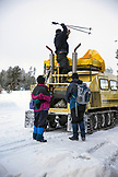 USA, Wyoming, Yellowstone National Park, loading tourists and cross country ski gear into a Snowcoach for a day trip, the Snow Lodge at Old Faithful, Upper Geyser Basin
