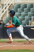 Ricardo Cespedes (7) of the Greensboro Grasshoppers follows through on his swing against the Kannapolis Intimidators at Kannapolis Intimidators Stadium on August 5, 2018 in Kannapolis, North Carolina. The Intimidators defeated the Grasshoppers 9-0 in game two of a double-header.  (Brian Westerholt/Four Seam Images)