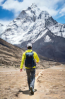 Hiking in the Khumbu Valley with Ama Dablam towering above and ahead. Nepal.