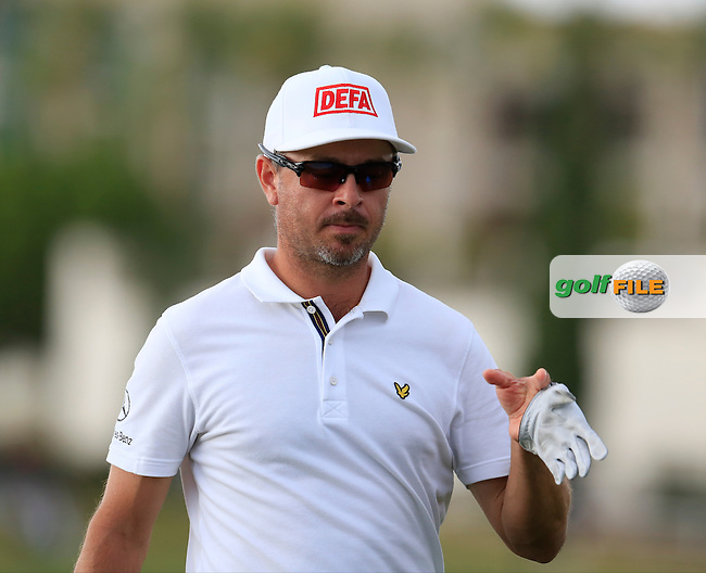 Mikko Korhonen (FIN) walks off the 14th green during Sunday's Final Round of the 2016 Portugal Masters held at the Oceanico Victoria Golf Course, Vilamoura, Algarve, Portugal. 23rd October 2016.<br /> Picture: Eoin Clarke | Golffile<br /> <br /> <br /> All photos usage must carry mandatory copyright credit (&copy; Golffile | Eoin Clarke)