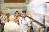 Teilnehmer der Radtour im Materiallager der Büttelborner Jugendförderung im Bürgerhaus Worfelden