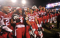NWA Media/Michael Woods --11/22/2014-- w @NWAMICHAELW...University of Arkansas players D.J. Dean, Keon Hatcher, Tevin Mitchel and the rest of the Razorbacks, celebrate on the sidelines after their 30-0 win over Ole Miss during Saturdays game at Razorback Stadium.