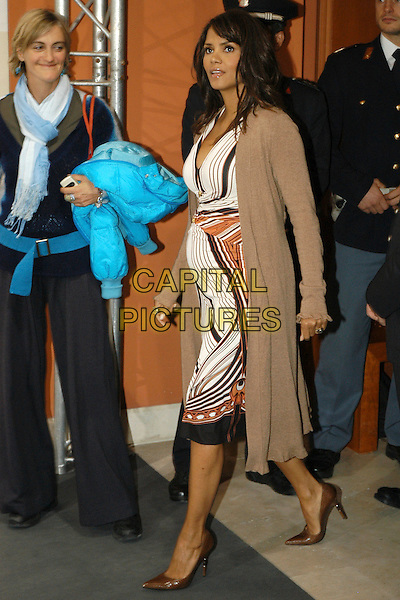 """HALLE BERRY.Photocall for the film """"Things We Lost In The Fire"""" at the 2nd annual Rome Film Festival, Rome, Italy. .October 26rd, 2007  .full length pregnant white black orange stripes striped pattern dress beige jumper jacket.CAP/CAV.©Luca Cavallari/Capital Pictures."""