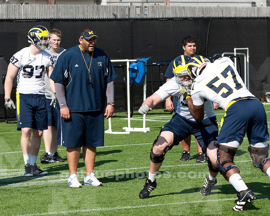 The University of Michigan football team on the first day of spring practice on the outdoor field at Glick Field House in Ann Arbor, Mich., on March 17, 2012.