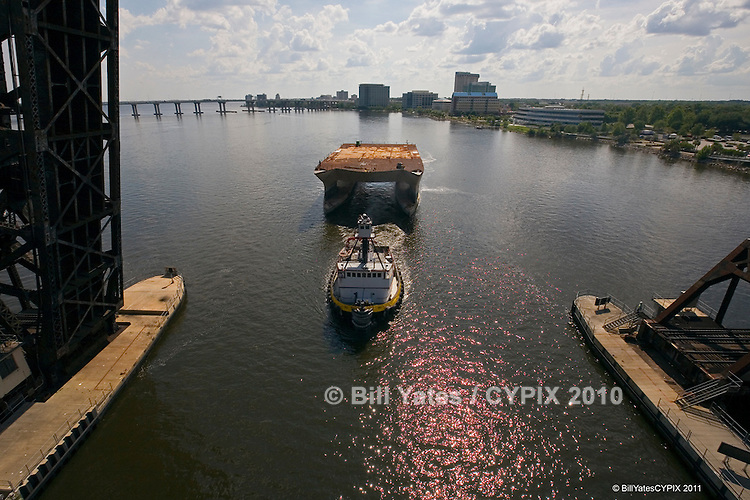 "Tug ""RHEA"" with SWATH vessel in tow - Smith Maritime, Inc., Green cove Springs, Florida"
