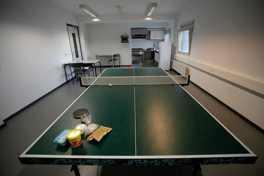 Food is left on a ping-pong table in a kitchen at one of the wings of the Detention Unit of the International Criminal Tribunal for the former Yugoslavia (ICTY) in Hague September 20, 2011. While awaiting or undergoing trial, around 40 people from the former Yugoslavia of different ethnic and religions accused of war crimes spend their time in peace and harmony at the detention unit of ICTY located within a Dutch prison complex in the Scheveningen neighborhood of Hague.  REUTERS/Damir Sagolj (NETHERLANDS)
