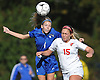 Kelsey Innes #4 of North Babylon, left, looks to head a ball away from Lauren Borelli #15 of East Islip during a Suffolk County Class AA varsity girls soccer first round playoff game at East Islip High School on Monday, Oct. 24, 2016. East Islip won by a score of 1-0.