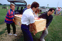 Pallbearers age 32 carrying grandma's plywood coffin to the grave.  Cambria Wisconsin USA