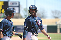 NWA Democrat-Gazette/J.T. WAMPLER Naturals' Nicky Lopez (LEFT) and Elier Hernandez smile after scoring in the eighth inning against San Antonio Tuesday April 10, 2018 at Arvest Ballpark in Springdale. The Naturals won 4-0.
