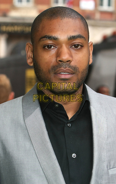 KANO (Kane Brett Robinson).European Premiere of 'Fire in Babylon' at the Odeon, Leicester Square, London, England, UK, May 9th 2011..portrait headshot black shirt grey gray stubble facial hair .CAP/ROS.©Steve Ross/Capital Pictures