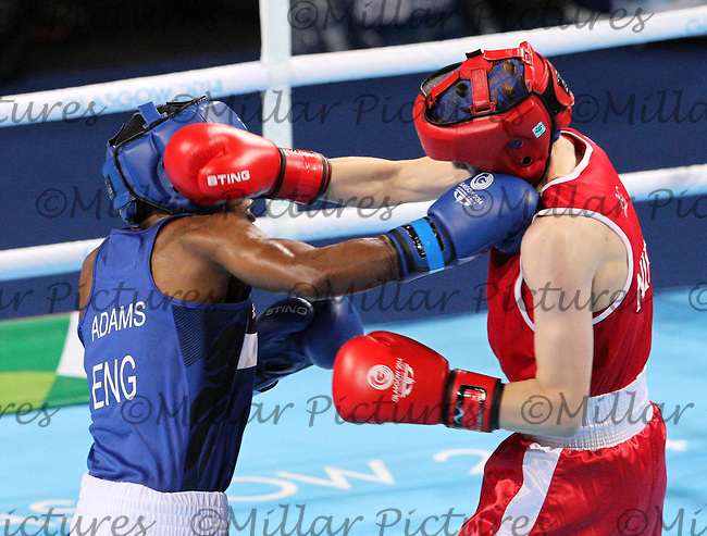 Michaela Walsh of Team Northern Ireland in the red vest against Nicola Adams MBE of Team England in the Women's Flyweight bout for the Gold Medal in the Boxing for the 20th Commonwealth Games, Glasgow 2014 at the SSE Hydro, Glasgow on 2.8.14.