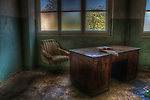 Old office somewhere in the old East Germany with desk and chair