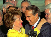 Elizabeth Dole, wife of United States Senate Majority Leader Bob Dole (Republican of Kansas), the presumptive 1996 Republican Party candidate for President of the United States, hugs her husband as he announces he will resign his seat in the US Senate on or before June 11, 1996 to concentrate on his presidential campaign in Washington, DC on Wednesday, May 15, 1996.  <br /> Credit: Arnie Sachs / CNP