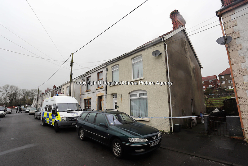 Pictured: Police still outside the family home (in beige) in Pontyberem, Carmarthenshire, west Wales. Wednesday 19 February 2014 <br />