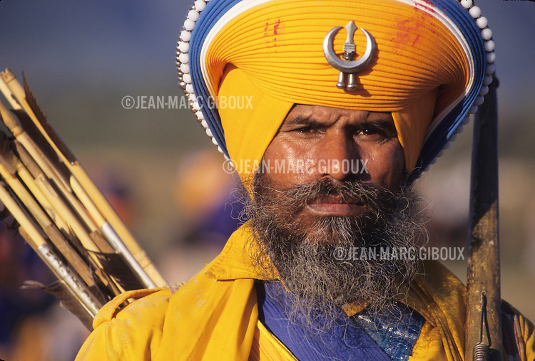 For the past 300 years the Nihangs, Holy warriors of Sikhism gather at the foothills of the Himalayas in Punjab to celebrate the Hola Mohalla,  the creation of the Sikh Army by Guru Gobind Singh to defend the Sikh homeland from the invading Mughal armies. Dressed in their traditional blue colors, they arrive barring their weapons  in Anandpur Sahib, demonstrating their prowess in martial arts and horse riding. Duels take place everywhere, while others prepare the 'Nectar', a cannabis-laced drink that they distribute freely.  (Photo by Jean-Marc Giboux)