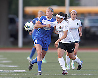 Boston Breakers defender Julie King (8) and Portland Thorns FC substitute forward Tiffany Weimer (19) battle for the ball.  In a National Women's Soccer League (NWSL) match, Boston Breakers (blue) defeated Portland Thorns FC (white/black), 2-1, at Dilboy Stadium on August 7, 2013.