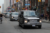 A long line of Police vans on the move in downtown Toronto on Yonge Street following a trail of vandalism and property damage Toronto g20 Saturday, June 26, 2010