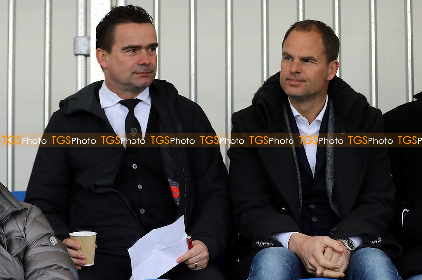 Marc Overmars, former Arsenal favourite and now Director of Football at Ajax and Ajax Manager, Frank De Boer sit together to watch the match during Chelsea Under-19 vs AFC Ajax Under-19, UEFA Youth League Football at the Cobham Training Ground on 15th March 2016