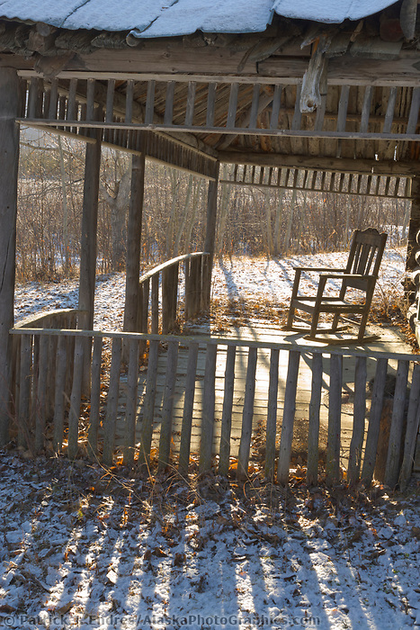 Rocking chair on front porch of old cabin in Wiseman, Alaska.