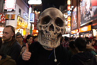 A man wearing a huge skull mask during the Halloween celebrations in Shibuya, Tokyo, Japan. Saturday October 29th 2016 Halloween celebration in Japan have grown massively in the last few years. To ensure the safety of the crowds in Shibuya this year, the police closed several roads leading to the famous Hachiko Square, allowing costumed revellers to spread over a larger area.