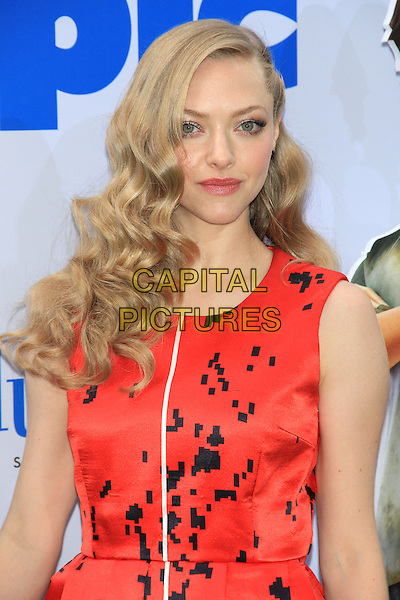 Amanda Seyfried .attending the New York film premiere of 'Epic' at the Ziegfeld Theatre, New York, NY, May 18th, 2013..portrait headshot red  black print white stripe sleeveless wavy curly hair .CAP/LNC/TOM.©TOM/LNC/Capital Pictures.