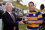 Counties Manukau President Henry Wilcox presents Siosuia Pole with the McNamara Cup. Counties Manukau Premier Club Rugby final between Patumahoe & Waiuku played at Bayers Growers Stadium Pukekohe on Saturday August 8th 2009. Patumahoe won 11 - 9 after leading 11 - 6 at halftime.