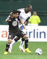 Cristian Castillo #12 of D.C. United is held up by Niouky Desire #23 of the New England Revolution during an MLS match on April 3 2010, at RFK Stadium in Washington D.C.