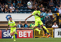 Marcus Bean of Wycombe Wanderers challenges Kurtis Guthrie of Colchester United during the Sky Bet League 2 match between Wycombe Wanderers and Colchester United at Adams Park, High Wycombe, England on 27 August 2016. Photo by Liam McAvoy.