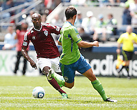 Colorado Rapids forward Omar Cummings changes direction on Seattle Sounders FC defender Patrick Ianni during play at CenturyLink Field in Seattle Saturday July 16, 2011. The Sounders won the game 4-3.