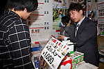 """An exhibitor promotes his product at the """"Japan Adult Expo 2014"""" on November 15 in Tokyo, Japan. The expo brings together for the first time 86 Japanese film production companies, makers and more than a hundred actresses connected to the adult industry on November 14 and 15. (Photo by Rodrigo Reyes Marin/AFLO)"""