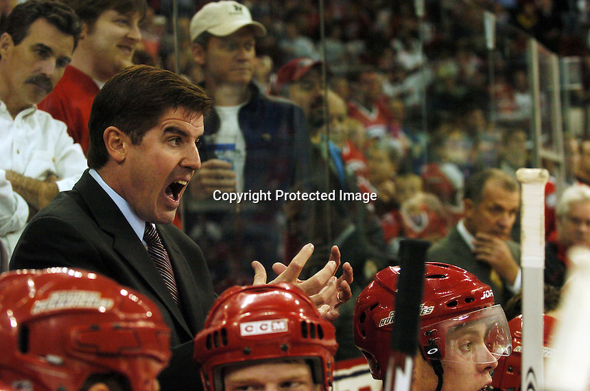 Carolina Hurricanes' head coach Peter Laviolette argues with the referees during a game against the Toronto Maple Leafs Tuesday, Nov. 3, 2005 in Raleigh, NC. Carolina won 4-3.