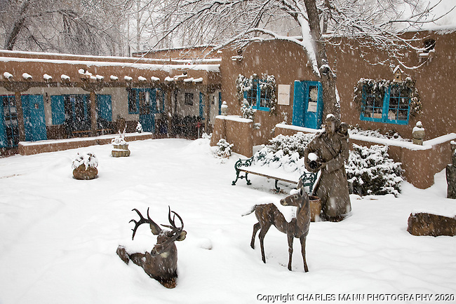 A Canyon Road gallery takes on a romantic air during a winter snowfall in Santa Fe, New Mexico
