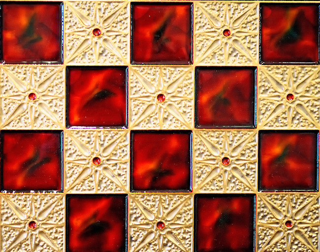 Closeup of red and gold chess board