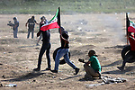 Palestinian protesters gather during clashes with Israeli security froces in a tent city protest where Palestinians demand the right to return to their homeland and against U.S. embassy move to Jerusalem at the Israel-Gaza border, at the Israel-Gaza border, in east of Gaza city, on June 1, 2018. Photo by Dawoud Abo Alkas