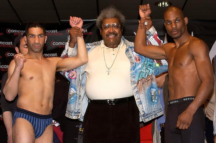 Bernard Hopkins (r), Don King and Morrade Hakkar during the weightin at the Spectrum in Philadelphia, PA on 03.28.2003 for  Hopkins upcoming fight against Morrade Hakkar.