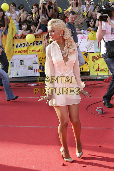 Christina Aguilera.Opening of the award of MUZ TV, Moscow, Russia..June 1st, 2007.full length white dress mini profile .CAP/PER/PK.©PK/PersonaStars/CapitalPictures